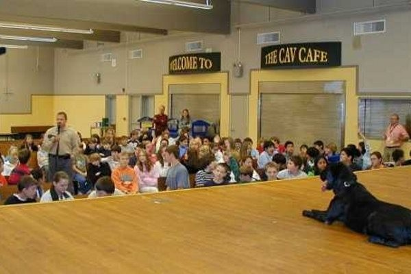 Contraband Detector Dog Cash giving a presentation to elementary school students!