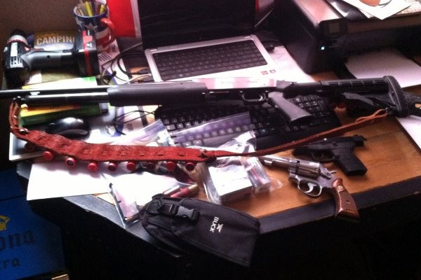 Loaded shotgun and handguns found in crew quarters.
