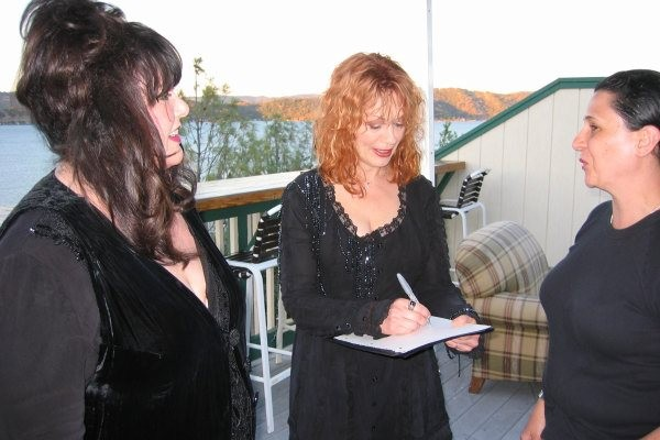 Ann and Nancy Wilson of Heart autographing during a meet-and-greet.