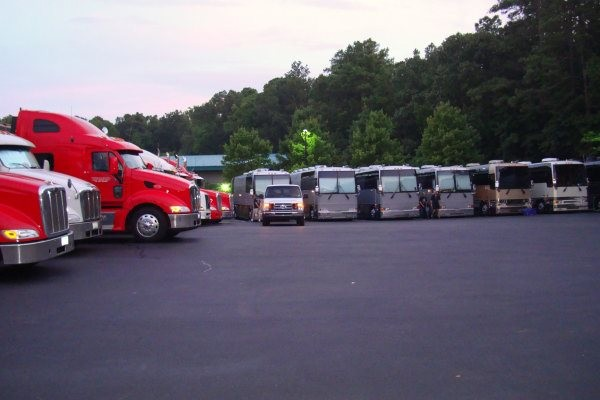 Heart, Cheap Trick and Journey tour busses and tractor trailers parked behind the stage.
